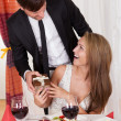 Man surprising his wife with a gift — Stock Photo