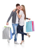 Guy and gal brings shopping bags — Stock Photo