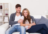 Couple sit on new couch — Stock Photo