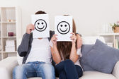 Couple covered faces — Stock Photo