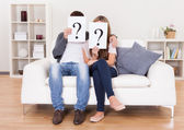 Couple with question marks — Stock Photo