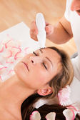 Attractive woman undergoes facial treatment — Stock Photo
