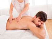 Man having a back massage — Stock Photo