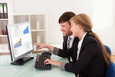 Business looking at sales charts — Stock Photo