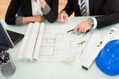 Architects discussing blueprints — Stock Photo