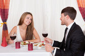 Loving couple enjoying a romantic meal — Stock Photo