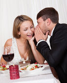Romantic lovers sharing secrets — Stock Photo