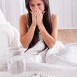 Woman ill in bed with a cold and flu — Stock Photo #15730305
