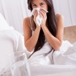 Woman ill in bed with a cold and flu — Stock Photo #15730311