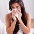 Woman ill in bed with a cold and flu — Stock Photo #15730313