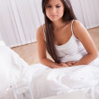 Woman with stomach pains in bed — Stock Photo #15730321