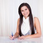 Woman sitting writing notes — Stock Photo