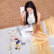 Woman working with her sewing machine — Stock Photo #15730539