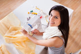 Woman working with her sewing machine — Stock Photo