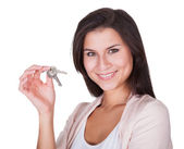 Smiling woman with a set of keys — Stock Photo