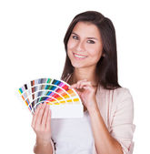Attractive woman chooses a color scheme — Stock Photo