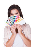 Attractive woman chooses a color scheme — Stock Photo