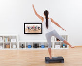 Athletic woman doing home exercises — Stock Photo