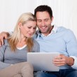 Couple looking at a tablet together — Stock Photo