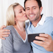 Stock Photo: Couple photographing themselves on a mobile