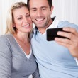 Royalty-Free Stock Photo: Couple photographing themselves on a mobile