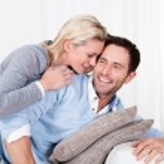 Happy man and woman cuddling — Stock Photo