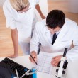 Lab technicians at work in a laboratory — Stock Photo