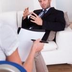 Man talking to his psychiatrist — Stock Photo #17392663