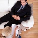 Man talking to his psychiatrist — Stock Photo