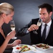 Romantic couple toasting each other — Stock Photo #17392837