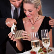 Romantic couple at the restaurant - Stock Photo