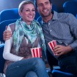 Stylish couple enjoying a movie - Stok fotoraf