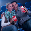 Stylish couple enjoying a movie - 