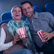 Stylish couple enjoying a movie - Stock Photo