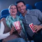 Stylish couple enjoying a movie — Stock Photo
