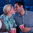 Loving couple sharing their popcorn — Stock Photo