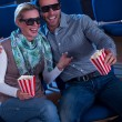 Lovely couple watching a 3d movie - 图库照片