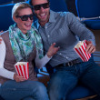 Lovely couple watching a 3d movie - Zdjęcie stockowe