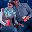 Lovely couple watching a 3d movie - Stock Photo