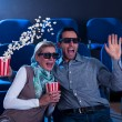 Couple reacting in shock to 3D movie — Stock Photo #17393199