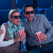 Couple reacting to a 3D movie - Stock Photo
