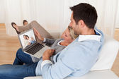 Loving couple having video conference — Stock Photo