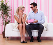 Couple in love romancing on the couch — Stock Photo