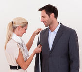 Seamstress measuring a man for a suit — Stock Photo