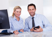Smiling accountants discussing reports — Stock Photo