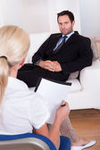 A middle aged smart male executive interviewing — Stock Photo
