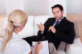 Man talking to his psychiatrist — Stock Photo