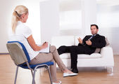 Man talking to his psychiatrist — Stok fotoğraf