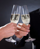 Romantic couple toasting each other — Stock Photo