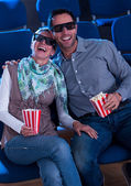 Lovely couple watching a 3d movie — Stockfoto